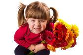 Cute little girl with gerbera flowers bouquet — Stock Photo