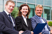 Group of business people working  on the bench — Stock Photo