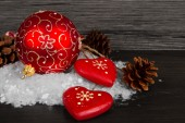 Red Christmas decorations on  snow — Stock Photo