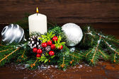 White Christmas decorations on spruce branches — Stock Photo