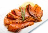 Smoked salmon on white dish with chive — Stock Photo