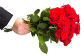 Man's hand with red roses bouquet — Stock Photo