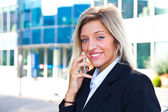 Business woman portrait outdoors talking at the phone — Stock Photo