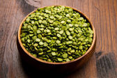 Dried peas on wood bowl — Stock Photo