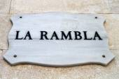 La Rambla- street sign depicting one of the first landmark in Ba — Stock Photo