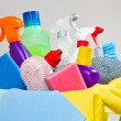 Full box of cleaning supplies and gloves isolated on white — Stock Photo #76919195