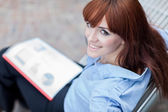 Portrait of smiling businesswoman with charts in her hands — Stock Photo