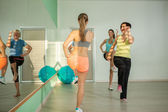 Small group of women are doing aerobics exercises in the fitness — Stock Photo