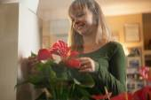 Female florist with her plants — Stock Photo