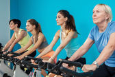 Four women are cycling at the fitness center — Foto Stock