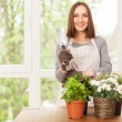 Woman doing some gardening at home — 图库照片 #71762183