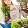 Woman doing some gardening at home — 图库照片 #71762219
