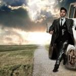 Robot businessman over landscape background — Stock Photo #72383569