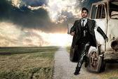 Robot businessman over landscape background — Stock Photo