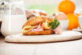 Delicious ham and cheese croissant — Stock Photo