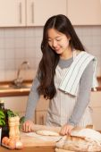Asian woman is baking bread — Stock Photo