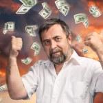 Man and rain of 100 dollar bills — Fotografia Stock  #54930851