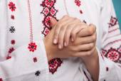 Hands of a young woman in the Ukrainian national clothes — Stock Photo