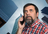 businessman talking on mobile phone in the megalopolis — Stock Photo
