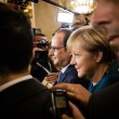 Постер, плакат: Angela Merkel and Francois Hollande after the meeting on the ASE