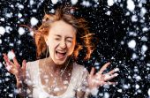 Listen to the Music on a snowfall background — Stock Photo