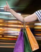 Sale. Hand with shopping bags — Stock Photo