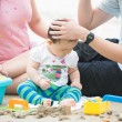 Asian family playing on a beach — Stock Photo #52165339