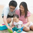 Asian family playing on a beach — Stock Photo #52165361
