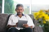 Indian male with a tablet — Stockfoto