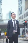 Businessman in busy central district — Stock Photo