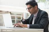 Indian business male with laptop — Foto de Stock