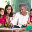 Indian family playing carrom game — Stock Photo #53085067