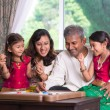 Indian family playing carrom game — Stock Photo #53085073