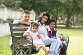 Indian family sitting on bench — Zdjęcie stockowe
