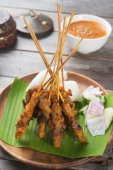 Satay with curry sauce — Stock Photo