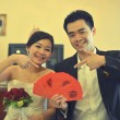 Chinese couple with ang paw red packet — Stock Photo #56034995