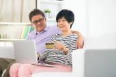 Asian senior couple online shopping — Stock Photo