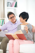 Asian senior couple reading book — Stock Photo