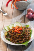 Spicy fried noodle with pork — Stock Photo