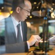 Asian business man having coffee — Stock Photo #56537153