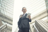 Asian businessman with tablet computer — Stock Photo