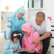 Southeast Asian family surfing internet — Stock Photo #57119997