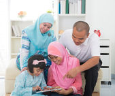 Southeast Asian family surfing internet — Stock Photo