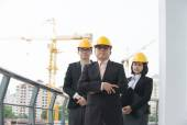 Asian architect team in discussion — Stock Photo
