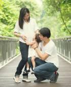 Asian family in park — Stock Photo
