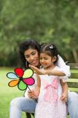 Indian mother and daughter playing — Stock Photo