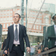 Businessman in busy central street — Stock Photo #67117741