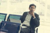 Indian business male at airport — Stock Photo