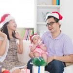 Asian family celebrating christmas — Stock Photo #72991101