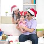 Asian family celebrating christmas — Stock Photo #72991045